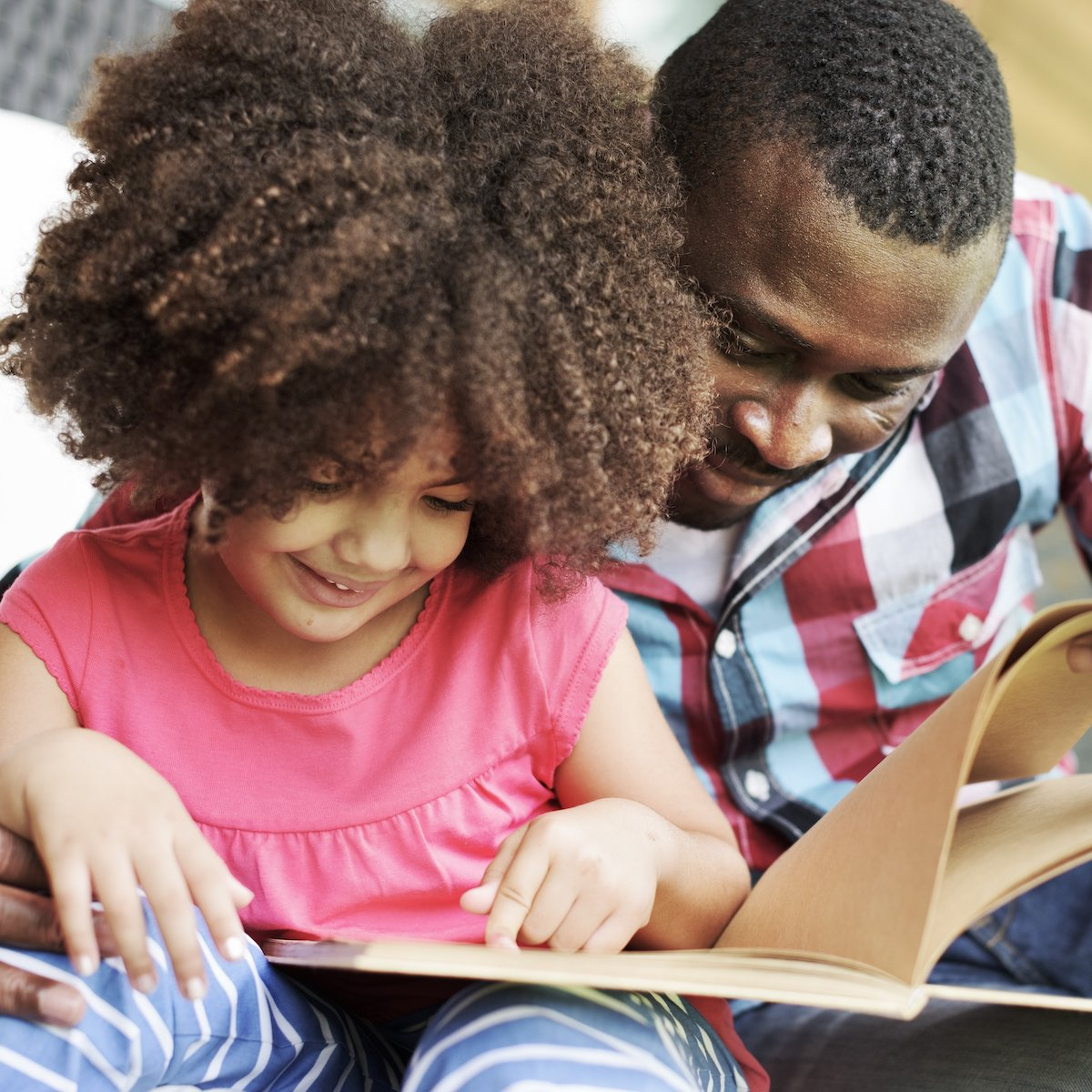 Young girl and father in family therapy, New City, NY