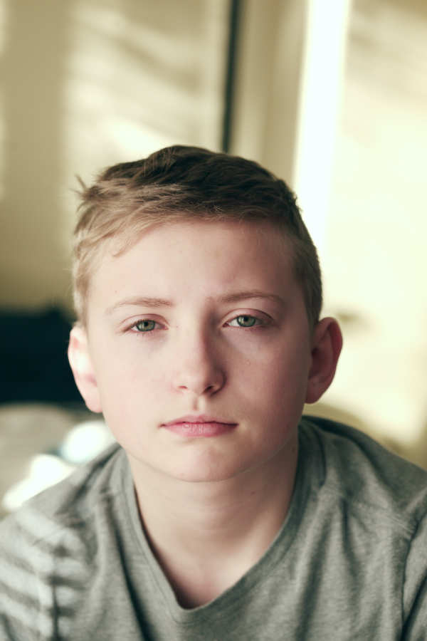 young boy seriously thinking about child therapy